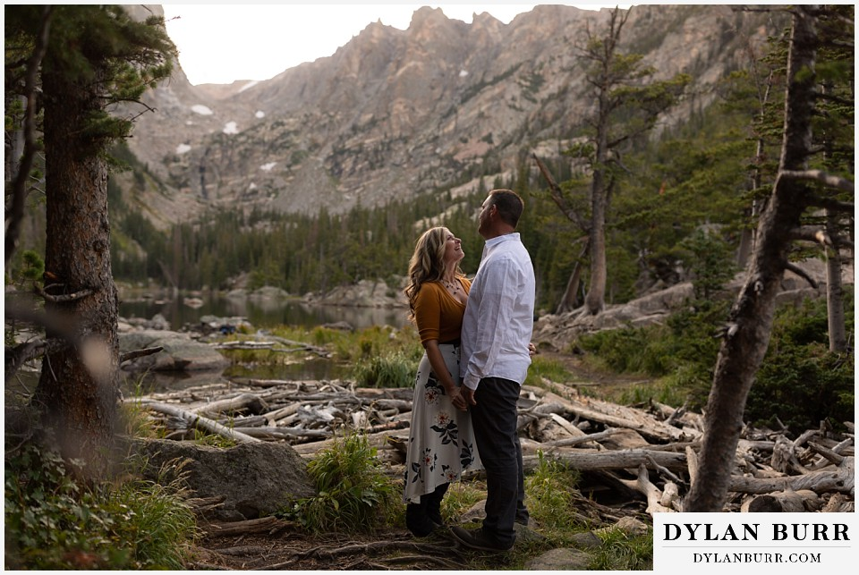 rocky mountain national park elopement wedding newlwed couple hiking in mountains by a alpine lake