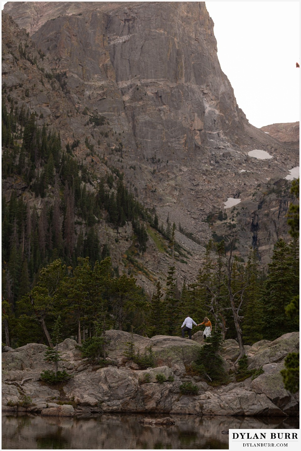 rocky mountain national park elopement wedding couple hiking with huge mountain views