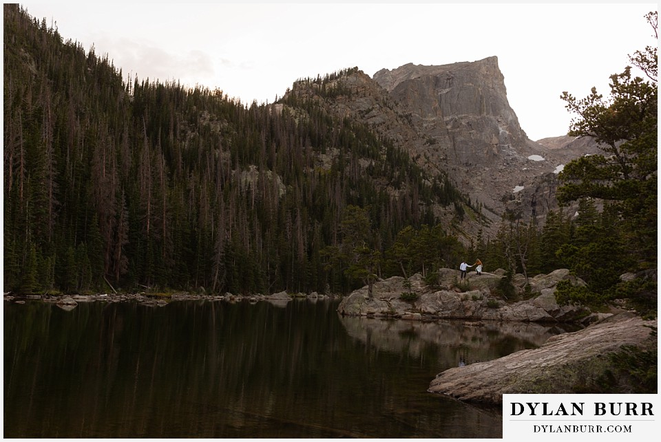 rocky mountain national park elopement wedding couple on mountain island in alpine lake