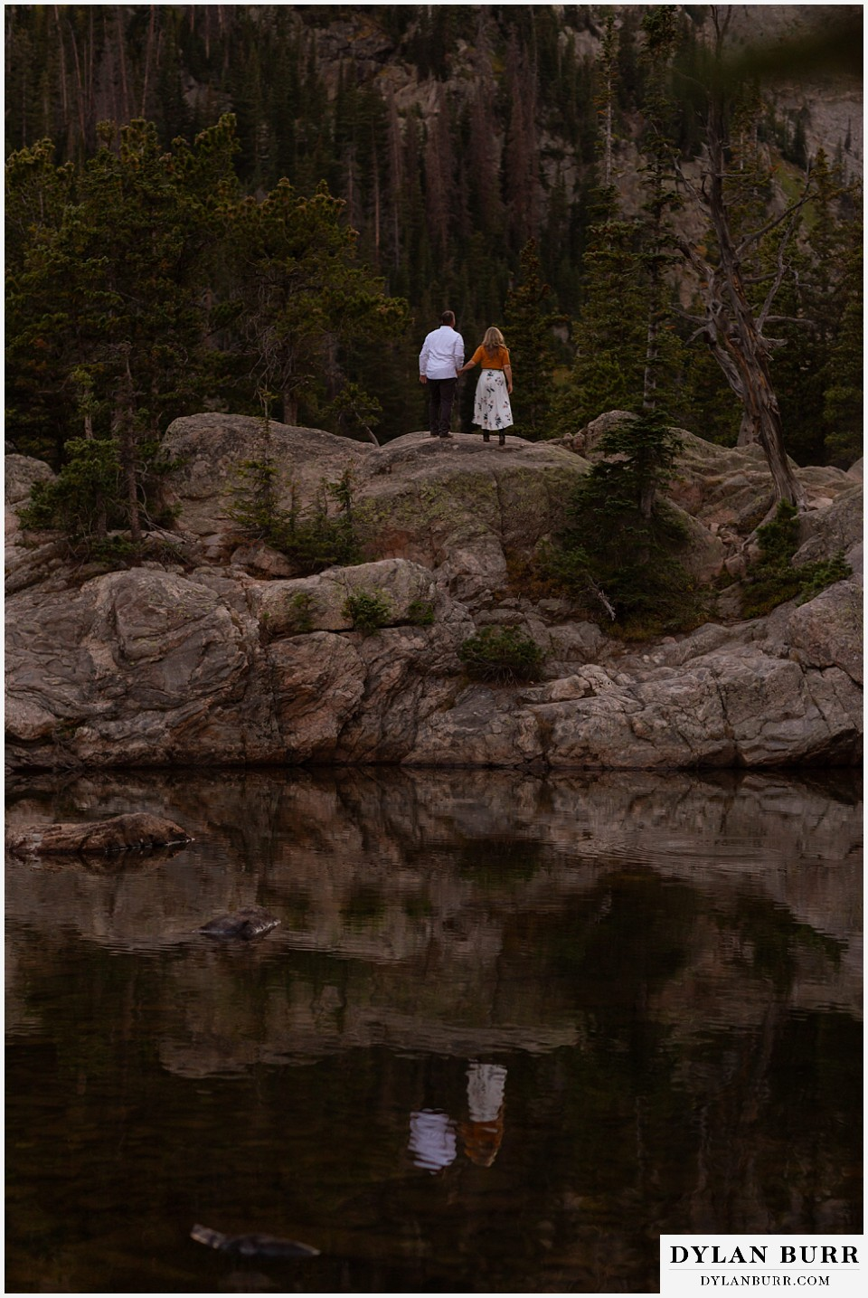 rocky mountain national park elopement wedding couple watching the sunset at a mountain lake