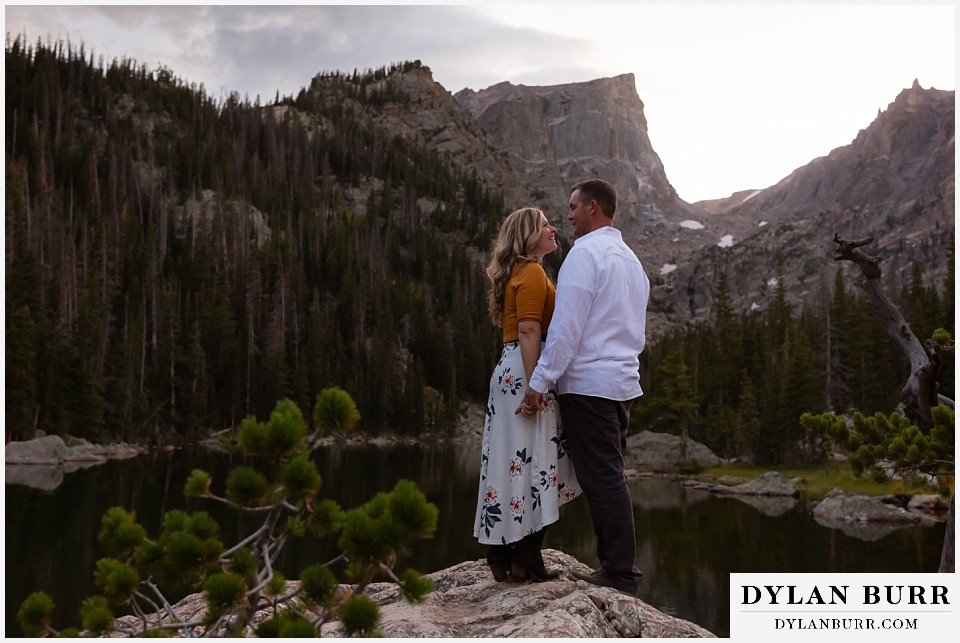 rocky mountain national park elopement wedding bride and groom by alpine lake at sunset