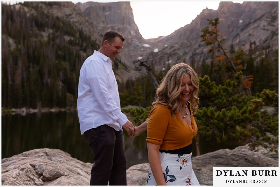rocky mountain national park elopement wedding bride and groom hiking down