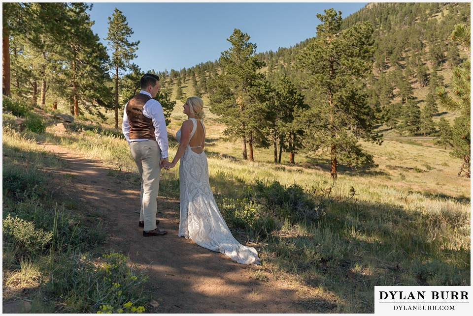 rocky mountain national park wedding elopement married bride and groom walk along a mountain trail