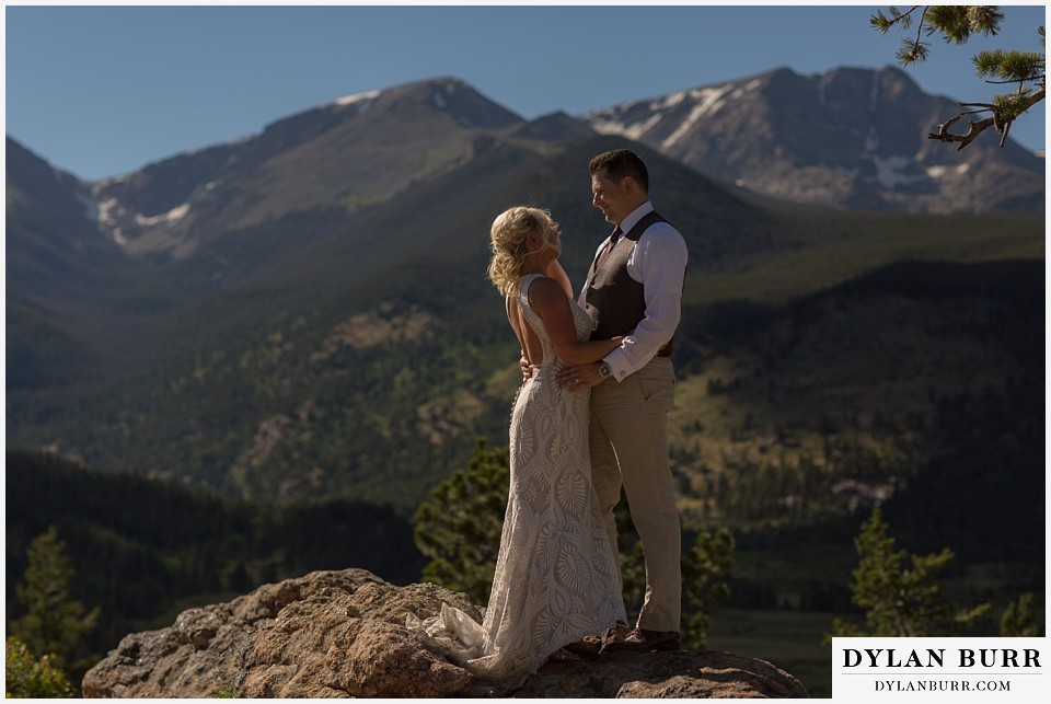 rocky mountain national park wedding elopement bride and groom take in the snow capped mountain views