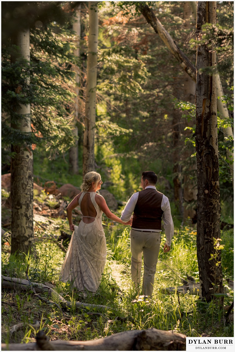 rocky mountain national park wedding elopement bride and groom adventuring in the forest