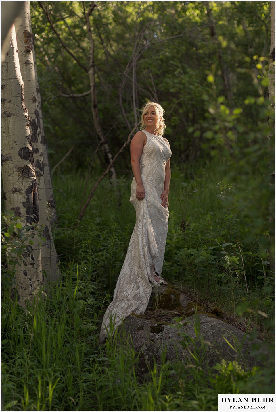 rocky mountain national park wedding elopement gorgeous bride lacy wedding dress in mountains