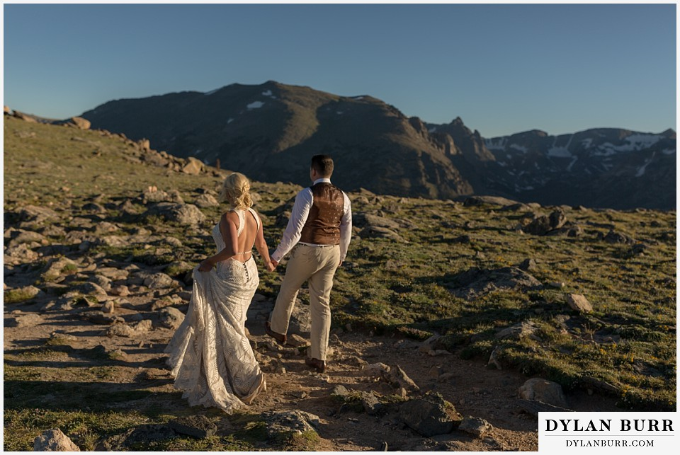 rocky mountain national park wedding elopement bride and groom walking on mountain alpine trail