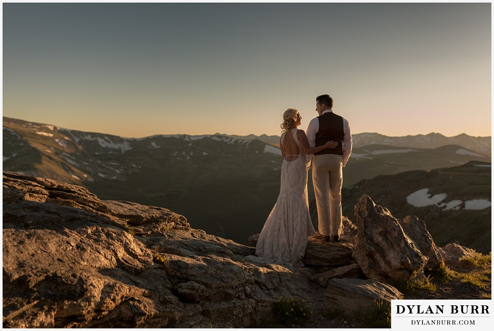 rocky mountain national park wedding elopement bride and groom high in the mountains with snow caps