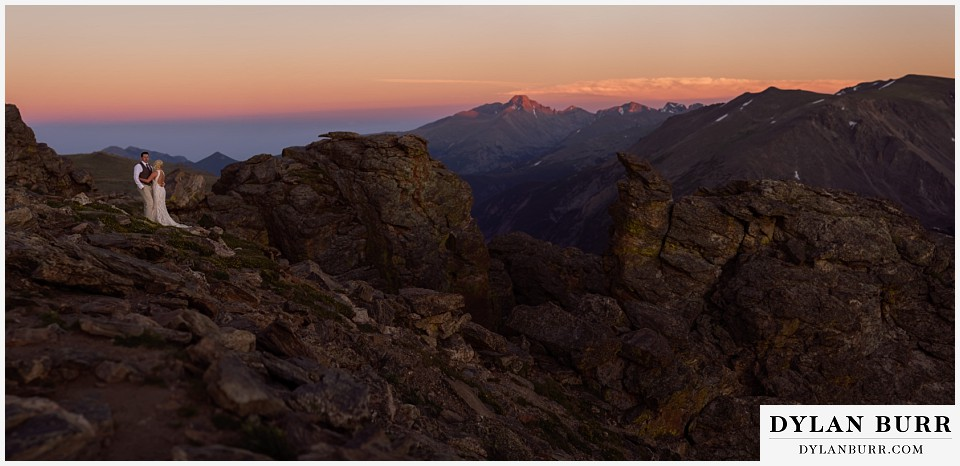 rocky mountain national park wedding elopement bride and groom panoramic view at sunset longs peak in distance
