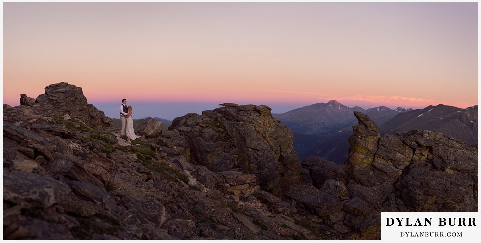 rocky mountain national park wedding elopement bride and groom at sunset on top of the mountains