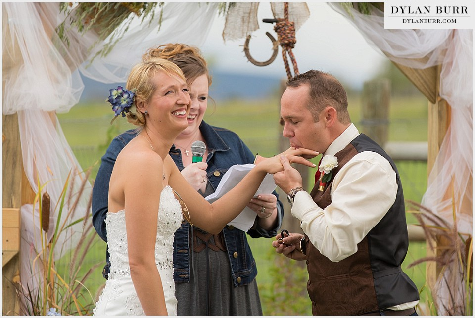 rustic outdoor colorado wedding licking brides finger montrose co