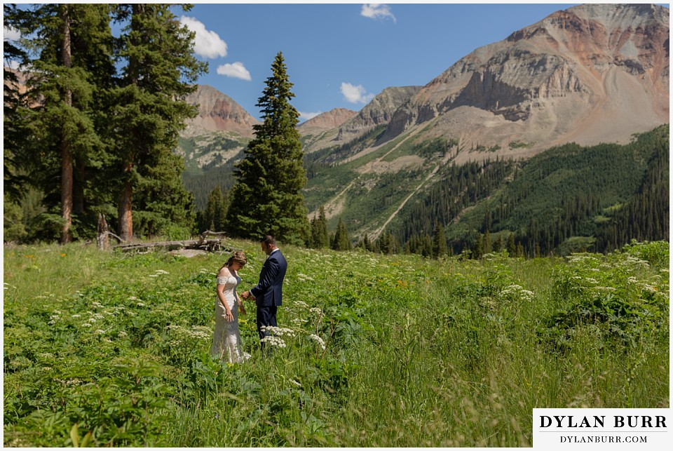 telluride colorado elopement wedding adventure bride and groom first look looking at each other