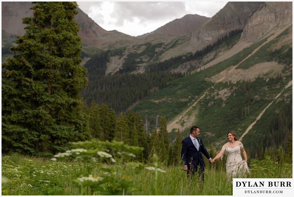 telluride colorado elopement wedding adventure bride and groom walking togeather in mountains