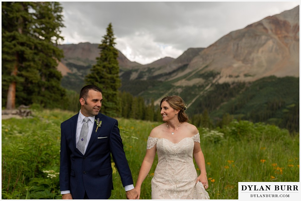 telluride colorado elopement wedding adventure bride and groom looking at each other with love in mountain