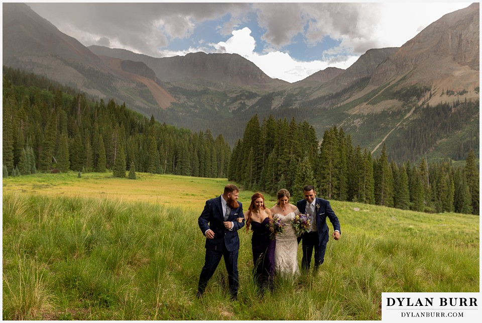 telluride colorado elopement wedding adventure bridal party together running in mountain rain