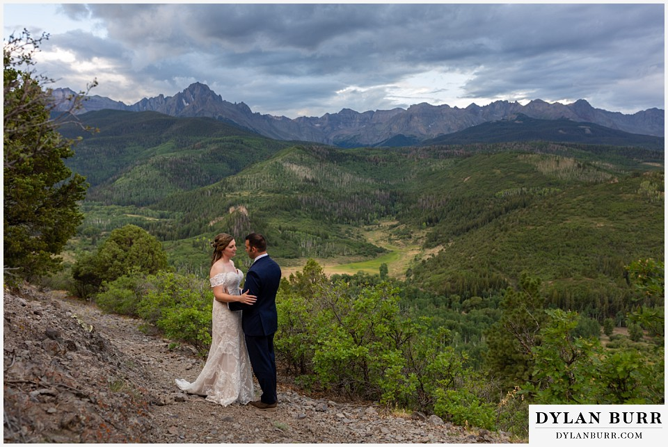 telluride colorado elopement wedding adventure bride and groom sharing a moment in mountains