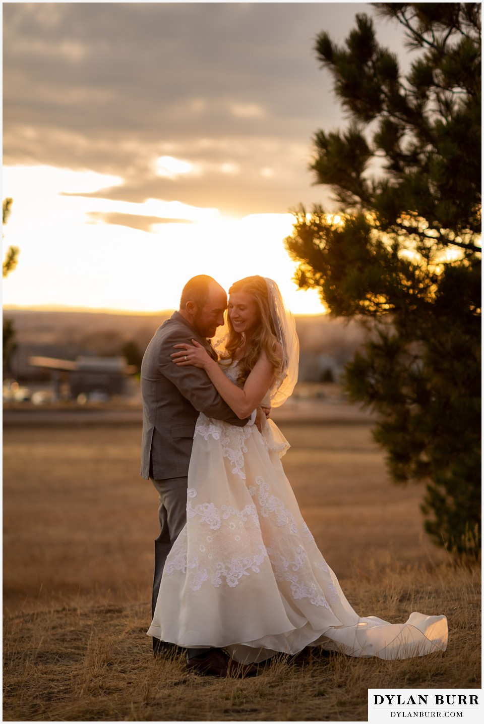 villa parker wedding parker colorado bride and groom snuggling in close at sunset