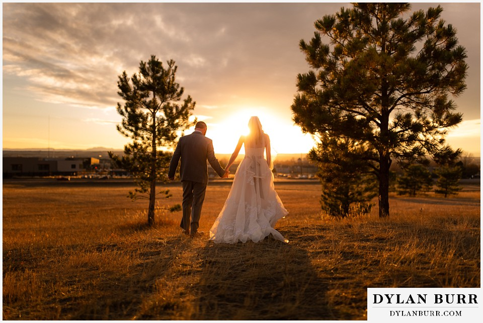 villa parker wedding parker colorado bride and groom walking out into the sunset