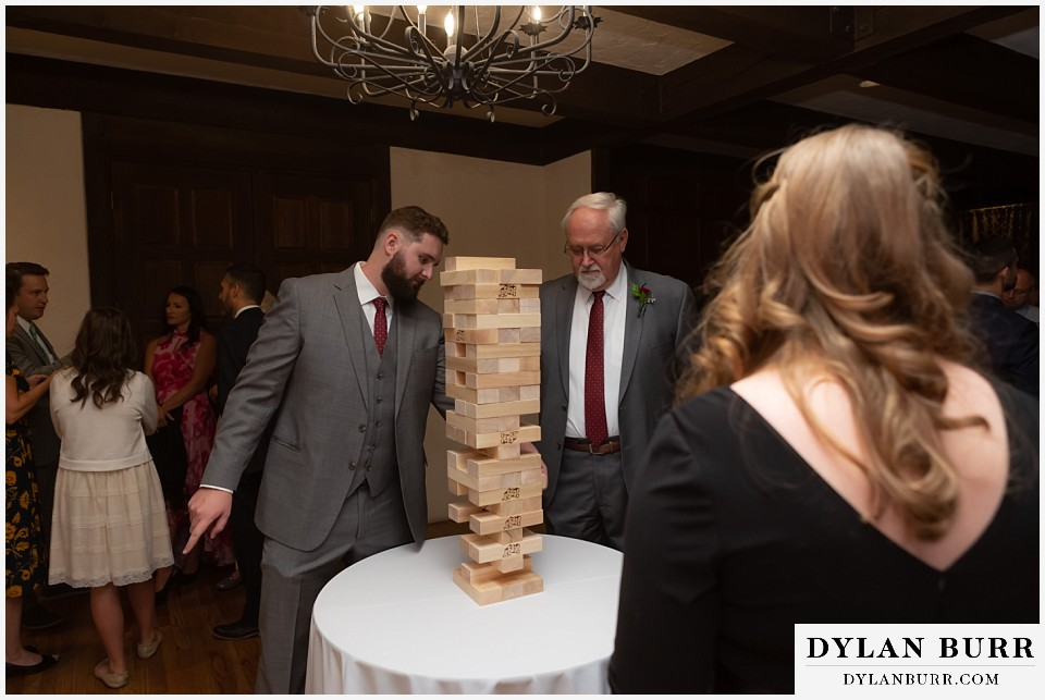 villa parker wedding parker colorado grooms family playing giant jenga