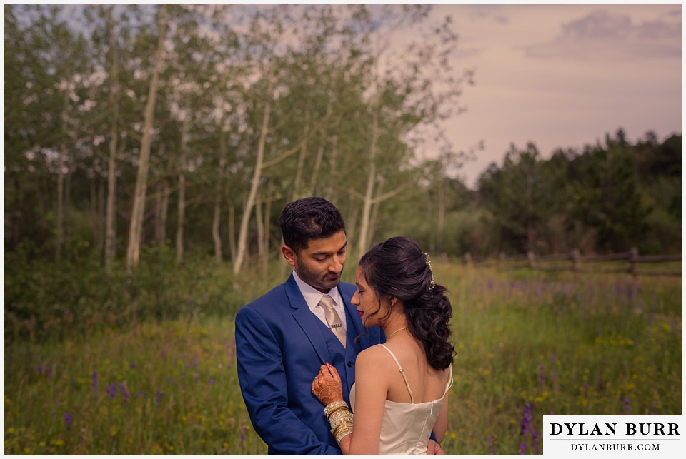 wild basin lodge hindu wedding couple wildflowers meadow