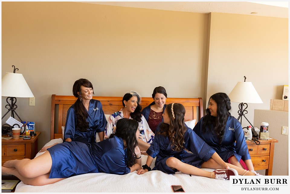 winter park mountain lodge wedding colorado bride and bridesmaids on bed in robes