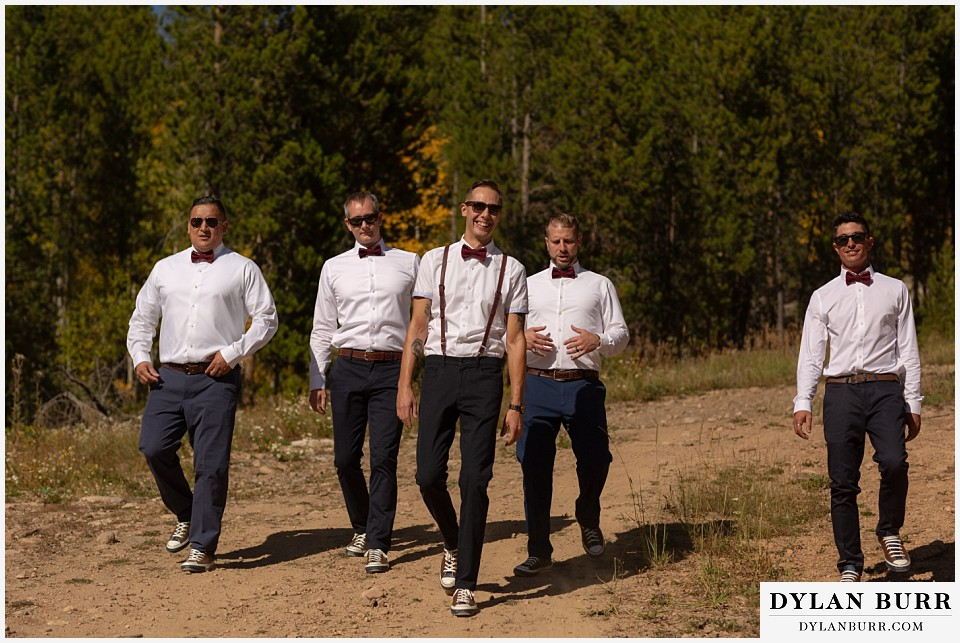 winter park mountain lodge wedding colorado groomsmen walking down mountain