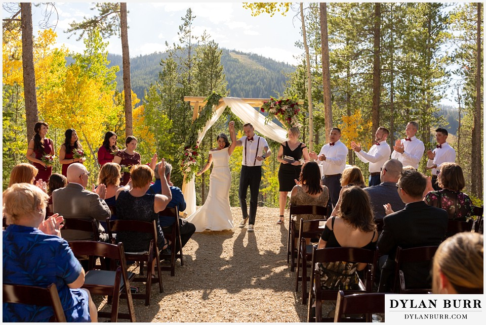 winter park mountain lodge wedding colorado happy newlyweds at wedding ceremony