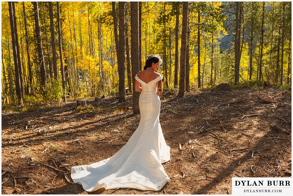 winter park mountain lodge wedding colorado bride alone in yellow aspen trees