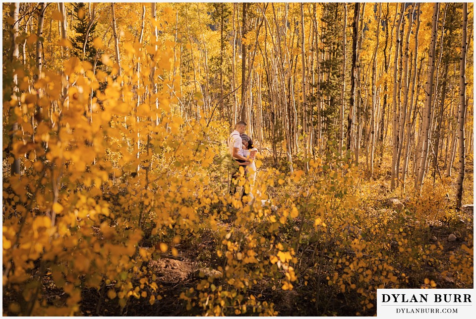 winter park mountain lodge wedding colorado bride and groom surrounded by yellow aspen trees