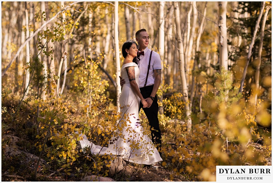 winter park mountain lodge wedding colorado bride and groom standing in sunlight