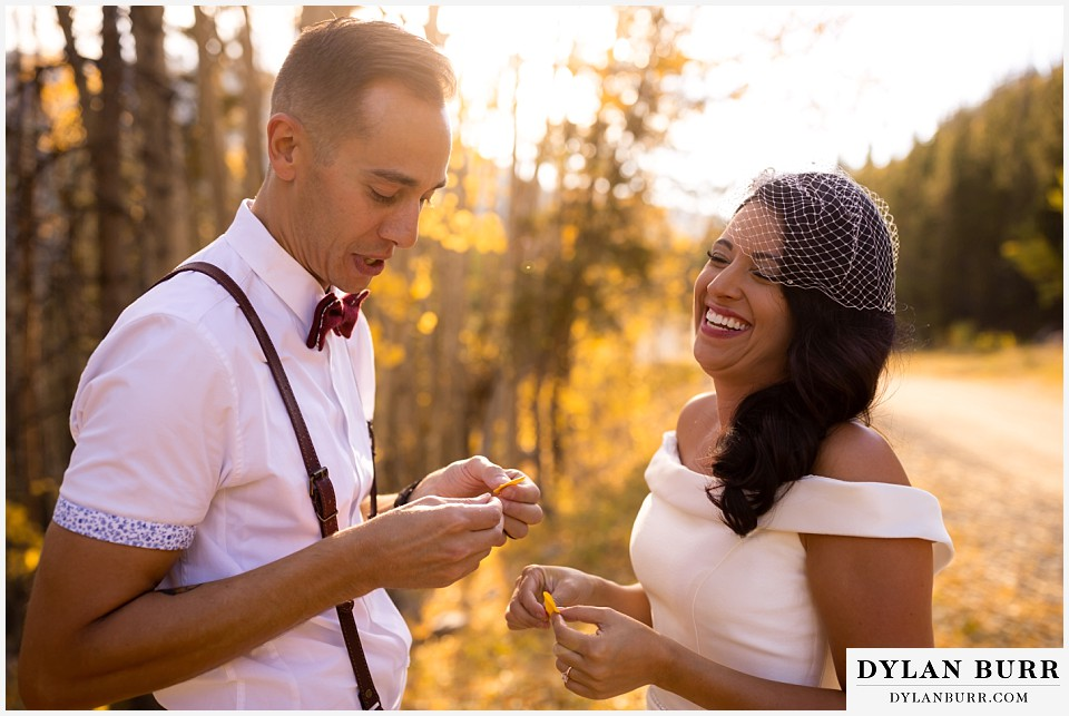 winter park mountain lodge wedding colorado bride and groom laughing together