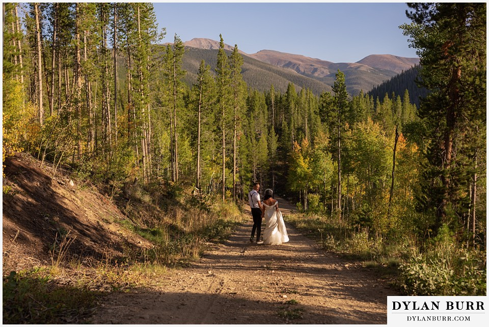 winter park mountain lodge wedding colorado bride and groom walking down the mountain