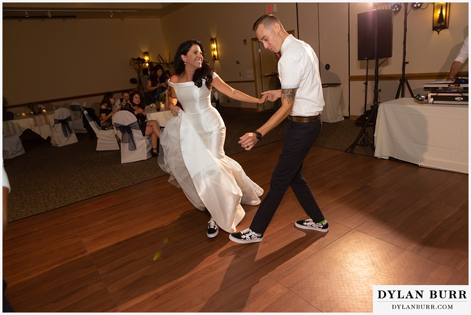 winter park mountain lodge wedding colorado bride and groom dancing in their tennis shoes