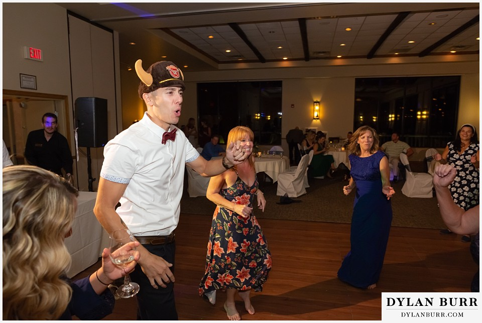 winter park mountain lodge wedding colorado groom dancing with hat on