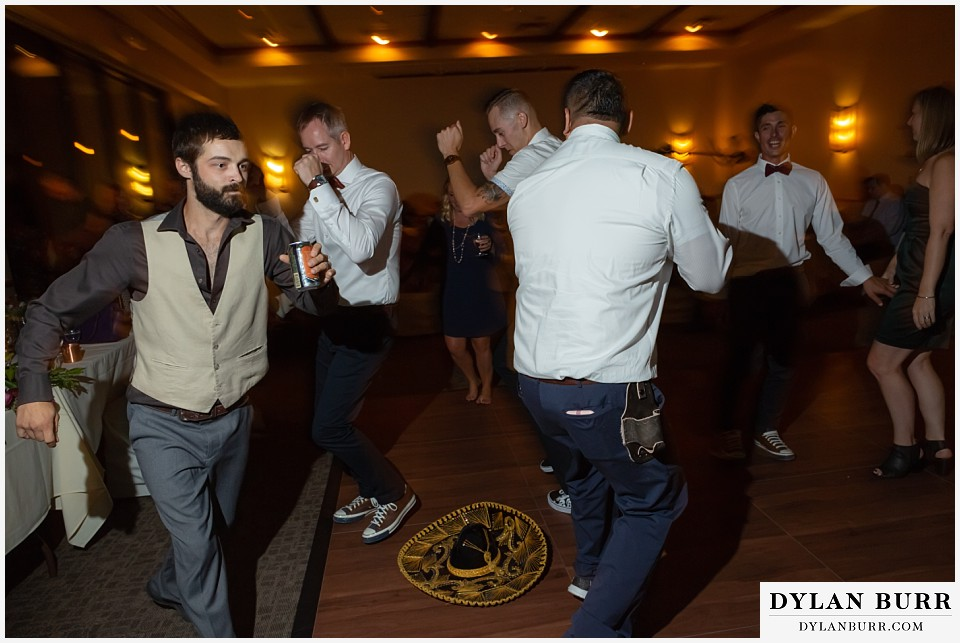 winter park mountain lodge wedding colorado groomsmen doing the hat dance on reception dance floor